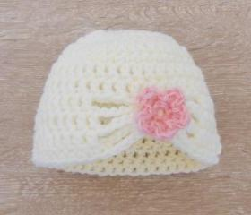 Crochet white baby hat with flower